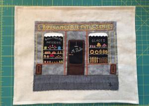 Trabajo de patchwork y bordado enmarcado
